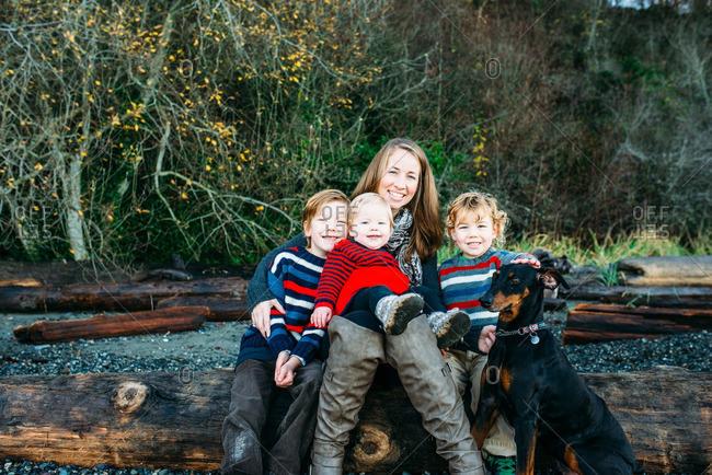 Mom and boys with dog on beach