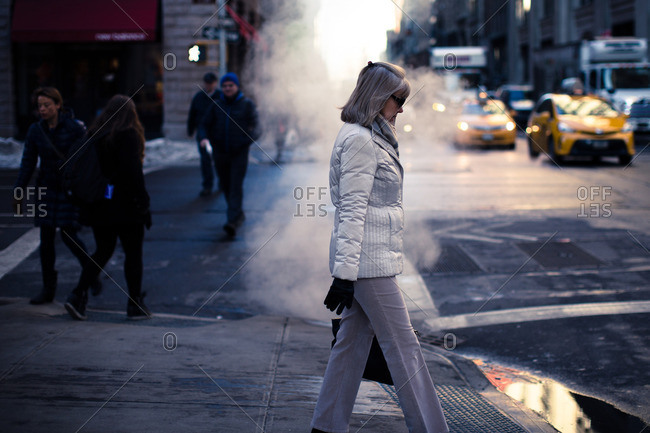New York City - January 28, 2016: Woman walking down 5th Avenue