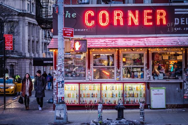 New York City - February 28, 2015: Corner Deli at dusk