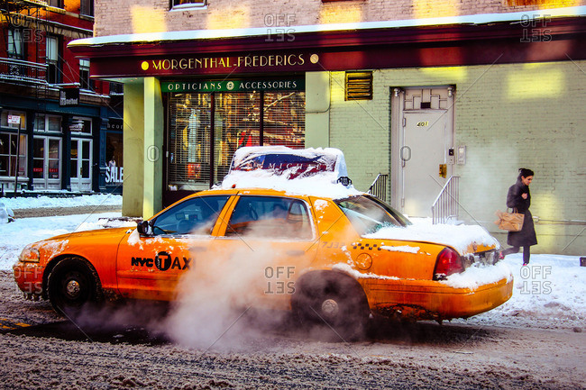 New York City - January 12, 2011: Cab driving in snowy street
