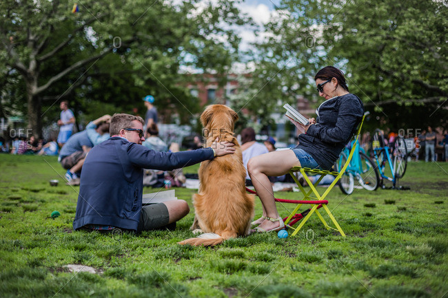 May 17, 2014: Couple with dog in summer park