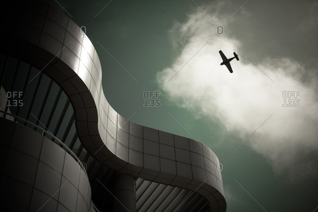 Los Angeles, California - April 7, 2013: Plane flying over Getty Museum