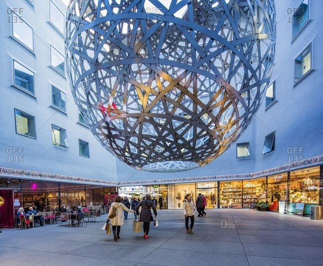Munich, Germany - December 14, 2015: Funf Hofe (Five Courtyards for the Munich City Centre), the Sphere 2013, a sculpture created by Olafur Eliasson in a courtyard