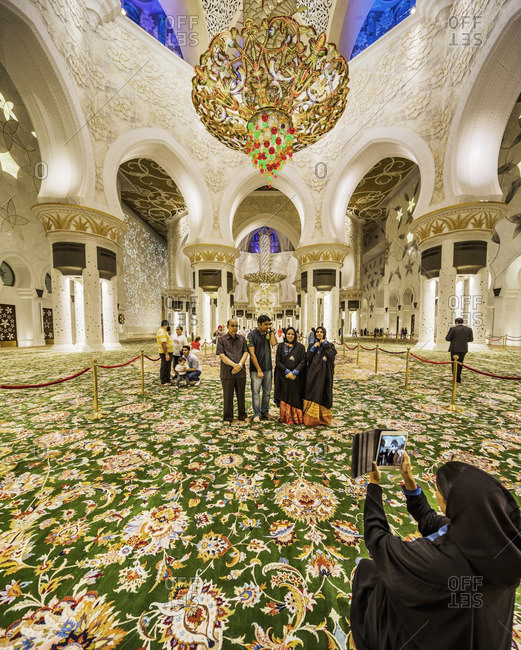 Abu Dhabi, United Arab Emirates - February 12, 2015: Taking photos inside the Sheikh Zayed Grand Mosque