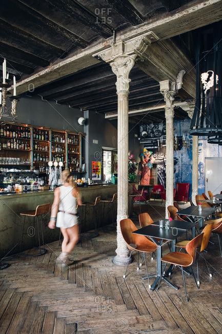 Barcelona, Spain - July 21, 2015: Restaurant with server walking