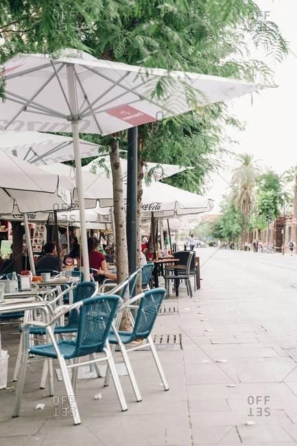 Sevilla, Spain - December 21, 2016: European cafe tables on street