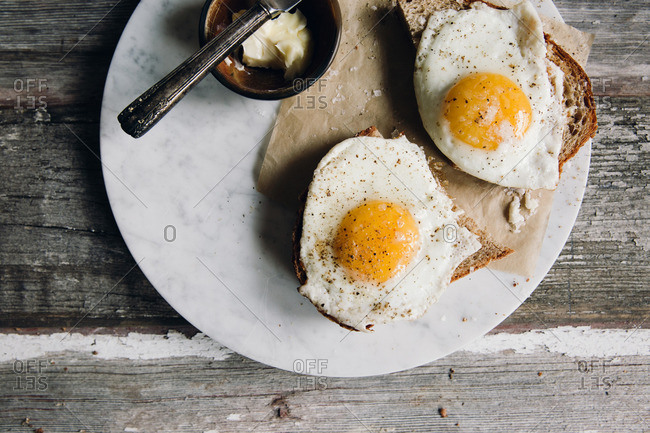 Two over sunny side up eggs on toast