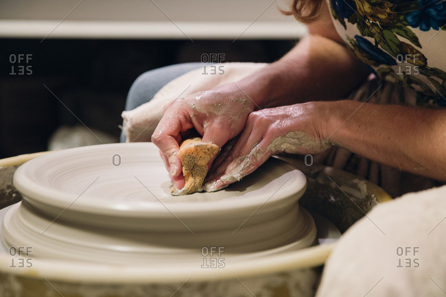 Woman hands on pottery wheel