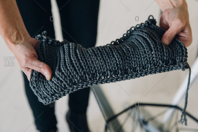 Woman hands holding piece of knitted fabric