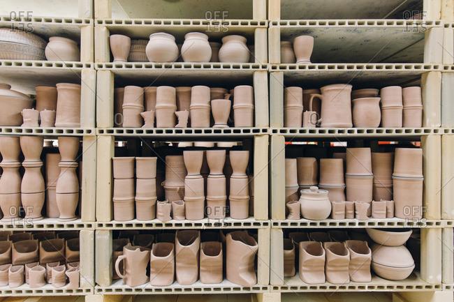 Shelves of unglazed pottery
