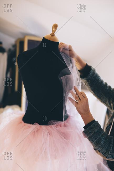 Dressmaker sewing in her fashion studio