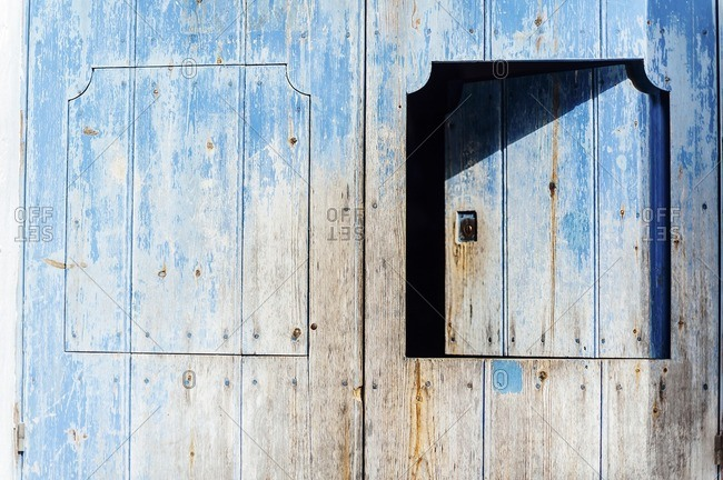 Ancient blue wooden door in Tarifa, Spain