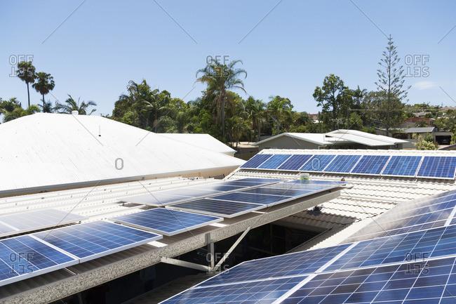 Solar panel installation on a bright, sunny day
