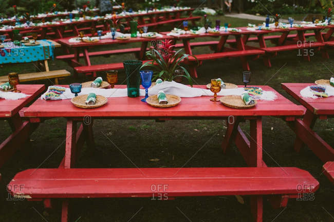 Picnic tables set for a Hawaiian themed wedding reception