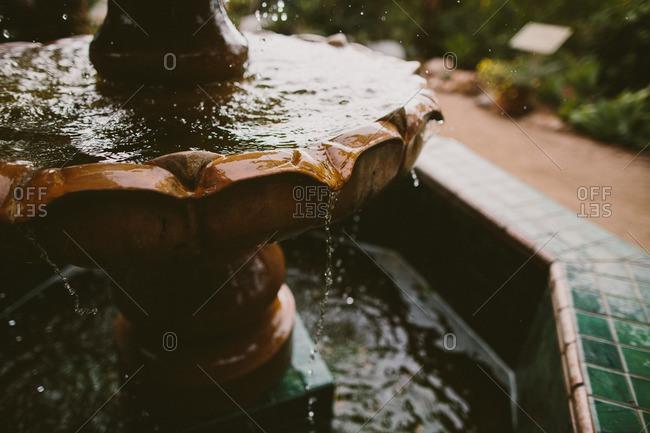 Water dripping from garden fountain