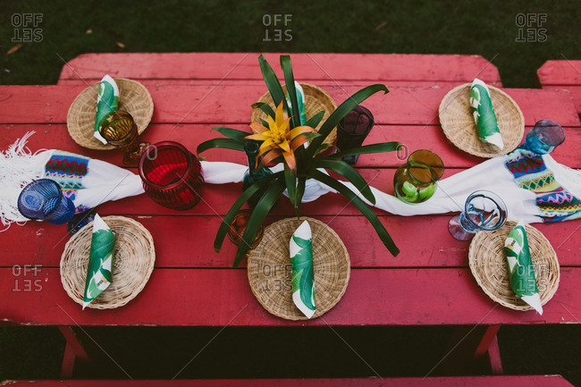 Picnic table set for a Hawaiian themed wedding reception