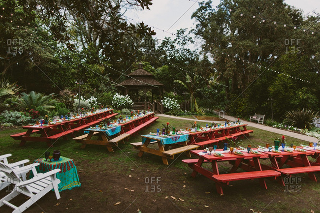 Picnic tables at a colorful wedding reception