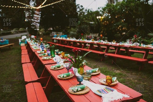 Hawaiian themed wedding reception with red picnic tables