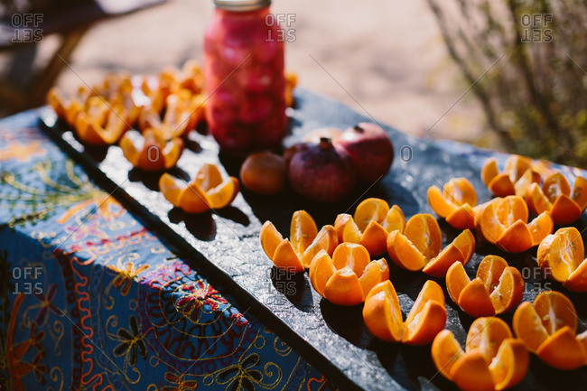 Sliced oranges and fruits on an outdoors table
