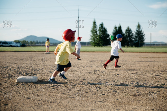 Little boy running off base after hit in t-ball