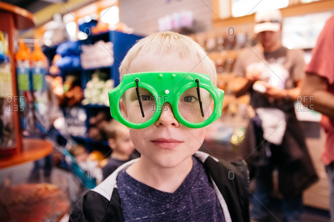 Boy wearing novelty glasses
