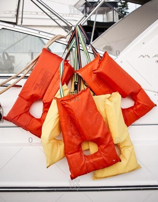 Life vests hanging on a boat