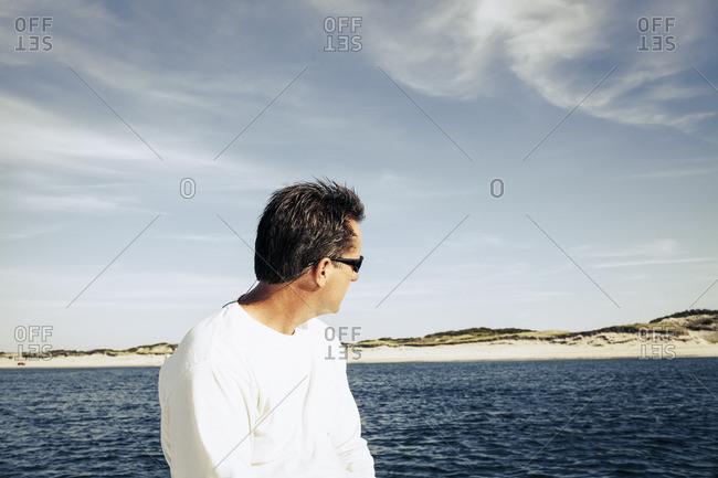 Man looking at beach from ocean