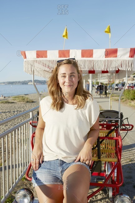 Women relaxing on pedal cart at beach
