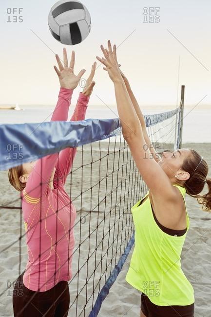 Women playing beach volleyball