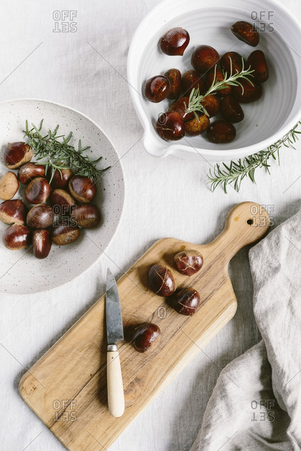Chestnuts are cut and placed in water before getting ready to be roasted.