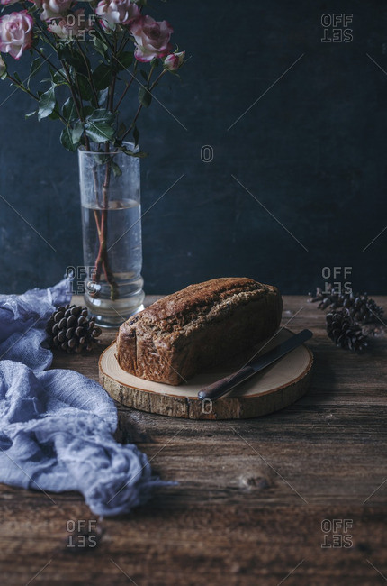 Banana chocolate chip bread on a wooden cutting board