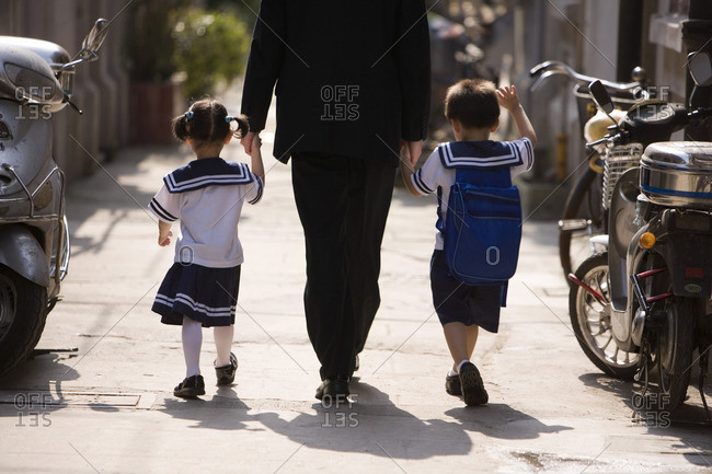 A father picks his children up from school