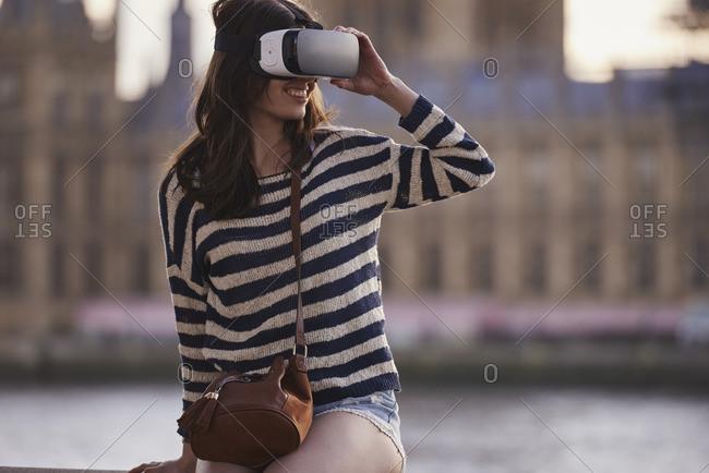 Beautiful woman wearing VR headset