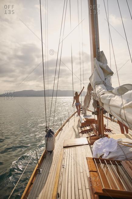 Beautiful woman on sailboat in bikini