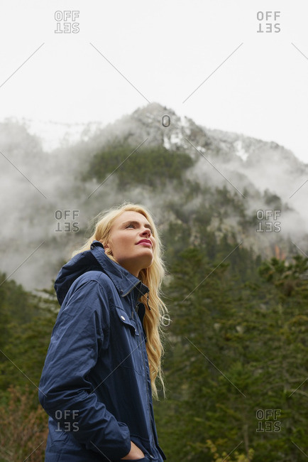 Adventure woman exploring in green forest