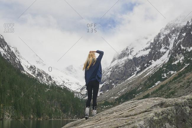Woman on mountain lake enjoying beautiful nature