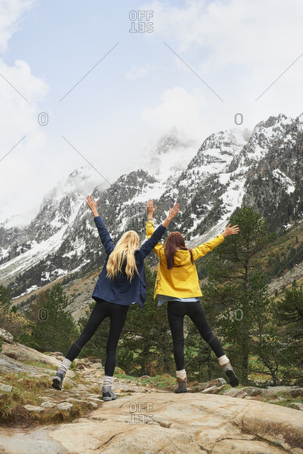Girls with arms outstretched enjoying beautiful nature
