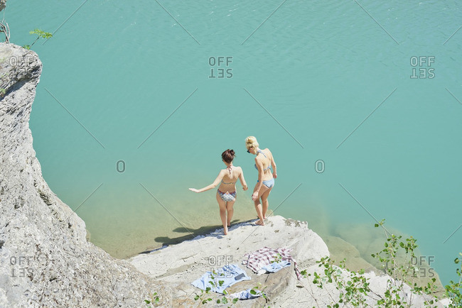 Beautiful girl friends testing water
