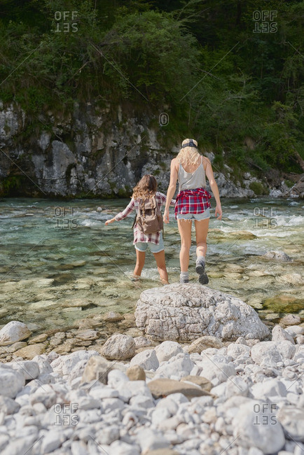 Brave friends cross river on adventure