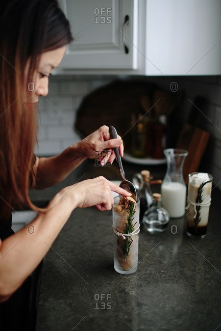 Woman making a white Russian float