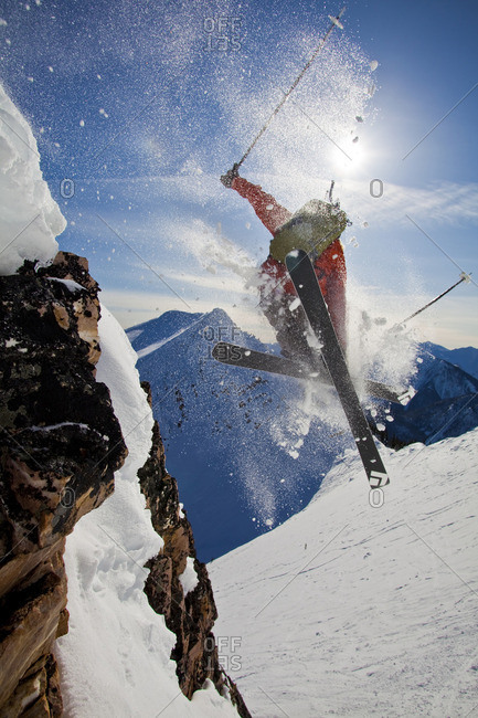 Golden, British Columbia - February 18, 2010: A young male skier airs a cliff in the kicking horse backcountry