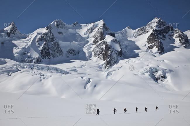 British Columbia, Canada - April 23, 2009: Backcountry skiers ski touring in the Selkirk Range near the Fairy Meadows Backcountry hut