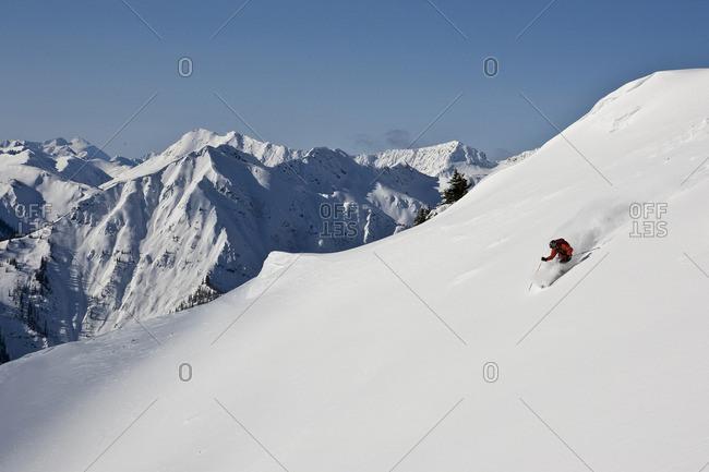 British Columbia, Canada - April 10, 2010: Young man skiing in Super Bowl, Kicking Horse Mountain Resort