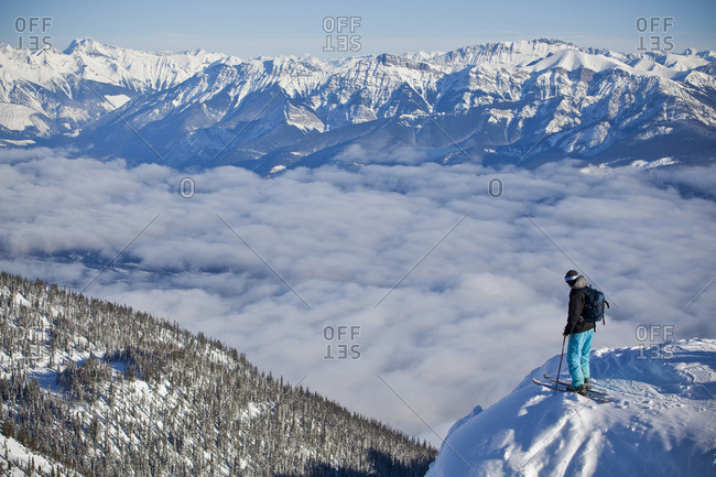 Golden, British Columbia - January 22, 2010: A young man enjoys the views at Kicking Horse Resort before dropping into a steep couloir