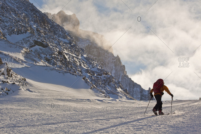 A man ski tours along the French/Haig Robertson Traverse, Peter Lougheed Provinicial Park, Kananaskis, Alberta, Canada