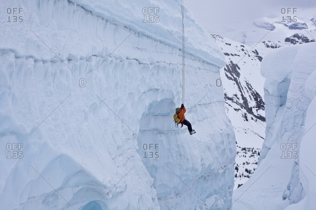 A man practicing crevasse rescue skills while on a ski mountaineering course, Ice fall Lodge, Golden, British Columbia, Canada