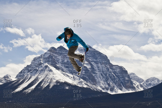 Alberta, Canada - May 4, 2011: Young man snowboarding at Lake Louise Resort, Banff National Park