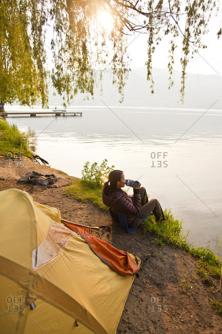 Penticton, British Columbia - May 28, 2011: A young woman camping by Skaha Lake