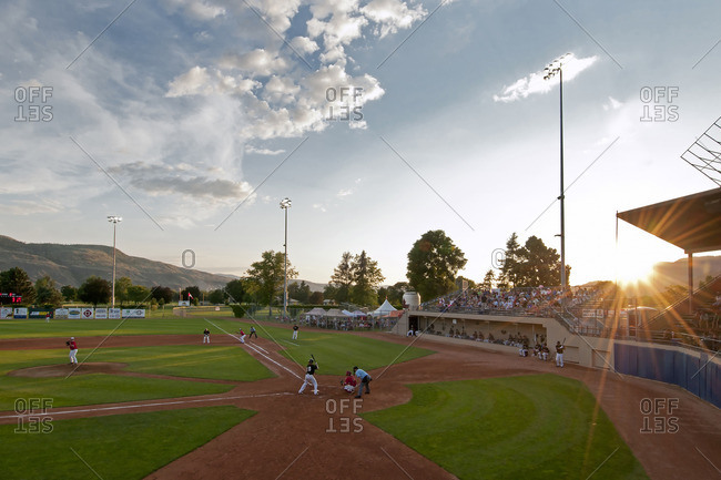 British Columbia, Canada - July 13, 2012: A baseball game being played at dusk in Kamloops, Thompson Okanagan region