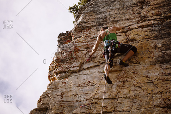 Alberta, Canada - September 21, 2011: A strong female climber getting ready to clip a bolt at Silver City